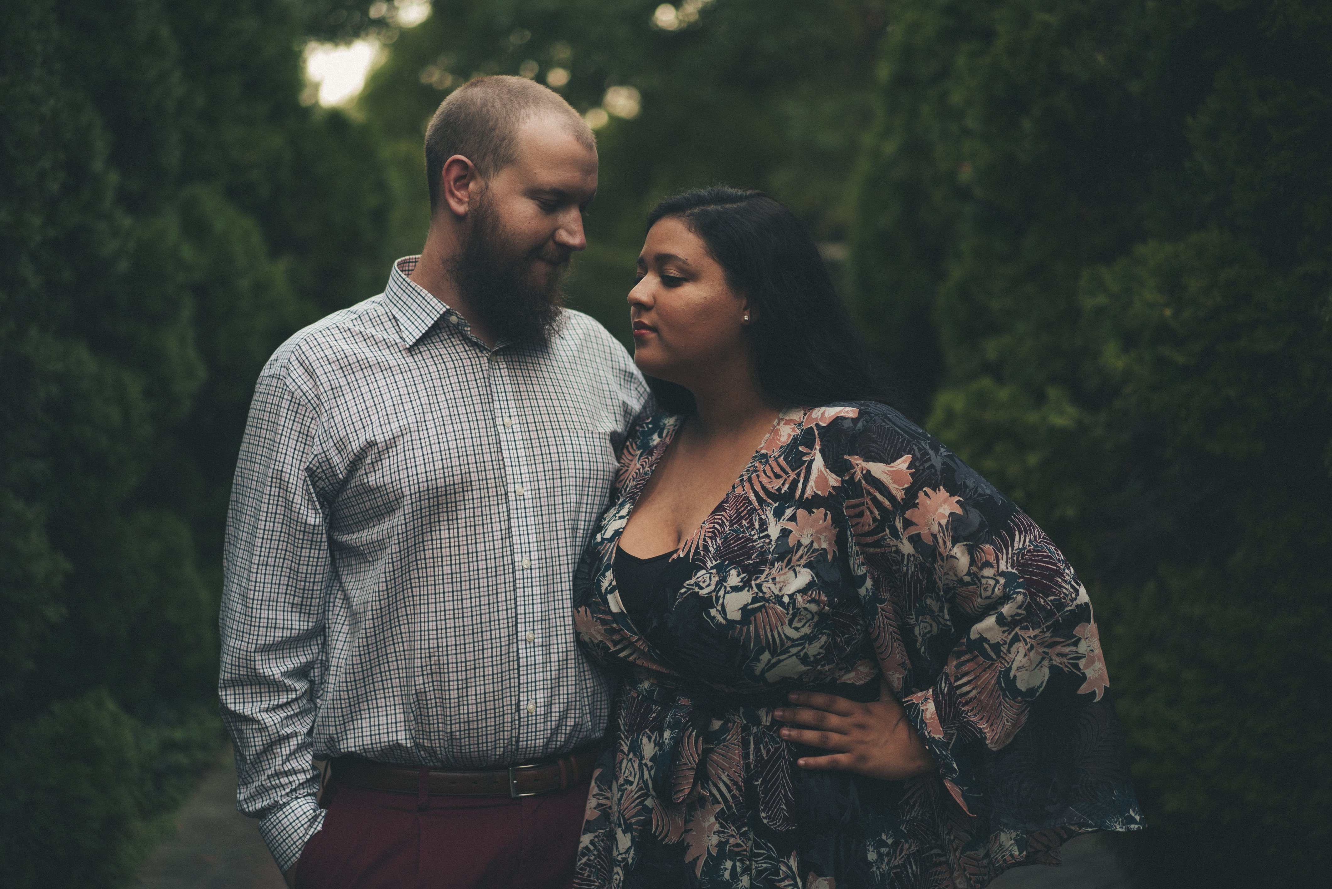Couple in close embrace at the Memphis Botanic Gardens in Memphis Tennessee